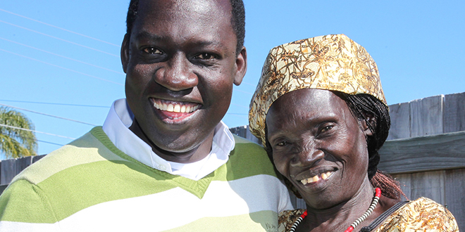 Happier times: Fr Ladu Yanga and his mother Kolorina Martin were reunited before his ordination to the priesthood in June 2013.