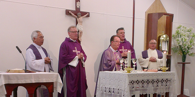 Priests celebrating the anniversary Mass.