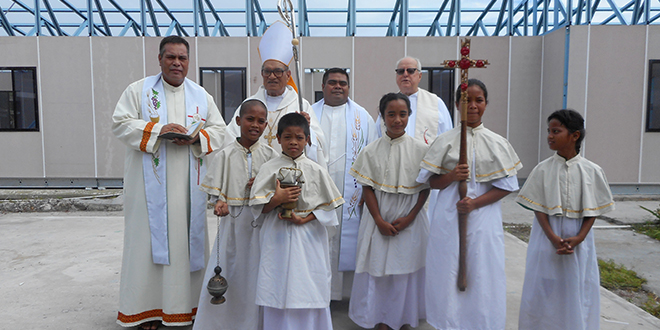 Merciful mission: At the blessing of new class-rooms on Naura are, from left, Fr Michael McKenzie (Kiribati) and MSC Bishop Paul Mea, Fathers Simon Kokoria and Adrian Meaney and local altar servers.