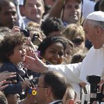 Pope Francis blesses child
