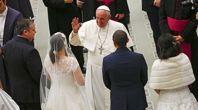 Pope Francis and newlyweds