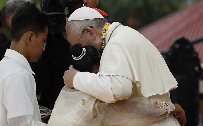 Pope Francis embraces child