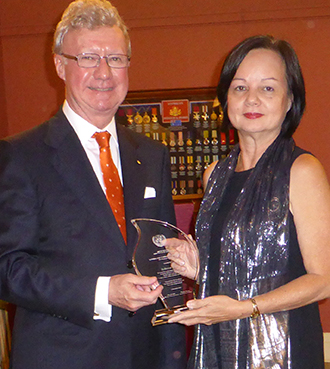 Dedicated to justice: Rebecca Lim is presented with a United Nations award for her work with asylum seekers by Queensland Governor Paul de Jersey in December.