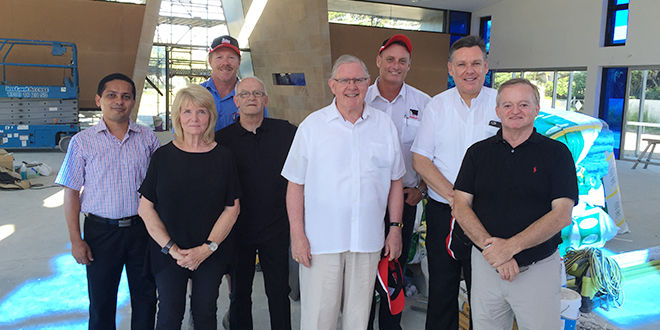 Building the Kingdom: Surfers Paradise associate pastor Fr Regimon Gervasis, Broadbeach church interior designer Sandra Dunn, project foreman Adam Clarke, architect Lee Dunn, Brisbane Archbishop Mark Coleridge, construction director John Wheeler, parish priest Fr Tim Harris and architect Patrick McGuinness inside the nearly-finished Stella Maris church.