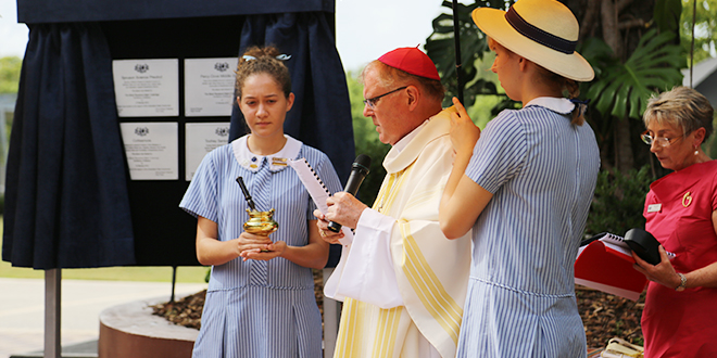 New face: Archbishop Mark Coleridge blesses the new Stuartholme School boarding house and science laboratories during his first visit to the school.