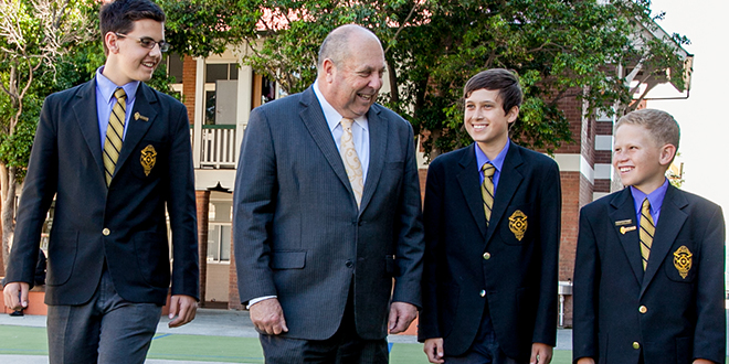 Laurie's now: St Laurence's College principal Ian McDonald and students.