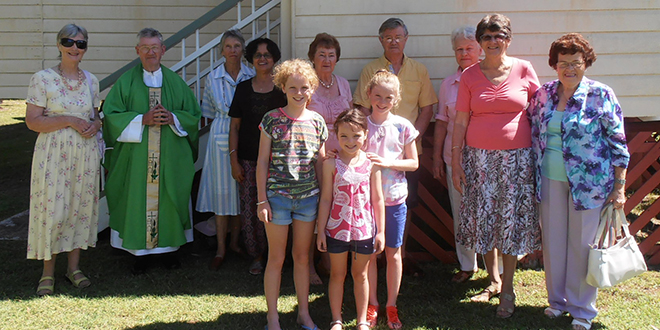 Faithful: Members of the small St Agatha's community at Toogoolawah with Esk parish priest Fr Terence Hegarty.