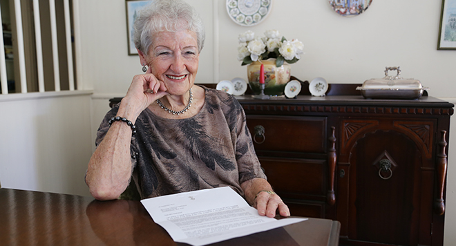 Honoured: Catholic woman Aileen Heathwood with her letter from the Governor General.