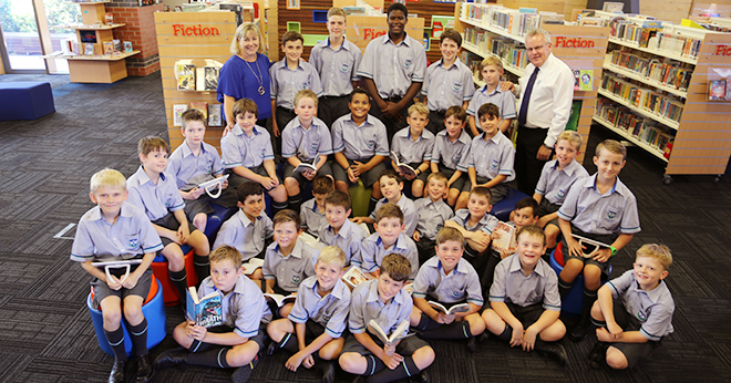 Educating young men: Some of Ambrose Treacy College's first Year 4 and (back row) Year 8 students with staff member Cathy Geraghty and principal Michael Senior.