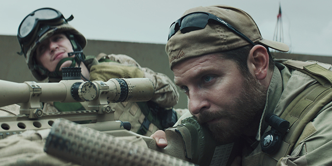 "Snipers: Kyle Gallner and Bradley Cooper star in a scene from the movie ""American Sniper"". Photo: CNS/Warner Bros."