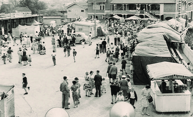 Golden days: The school fete in 1960, showing the O'Donnell Building under construction (top left) and the science laboratory (former mortuary) beside the original school building.