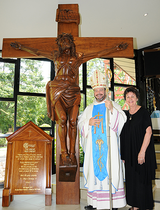 Prayer for priests: Heather Joseph and Bishop Columba Macbeth-Green at the crucifix dedicated in memoriam to the priests of Brisbane archdiocese.
