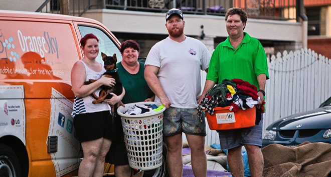 Welcome help: Grateful Orange Sky Laundry clients in the wake of Cyclone Marcia.