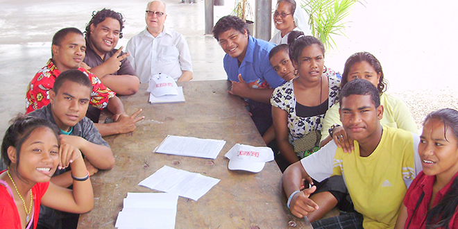 Care and concern: Fr Adrian Meaney with some Nauruan youth on his recent visit to the island.