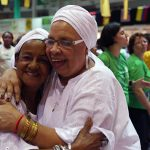 Brazilian women hug