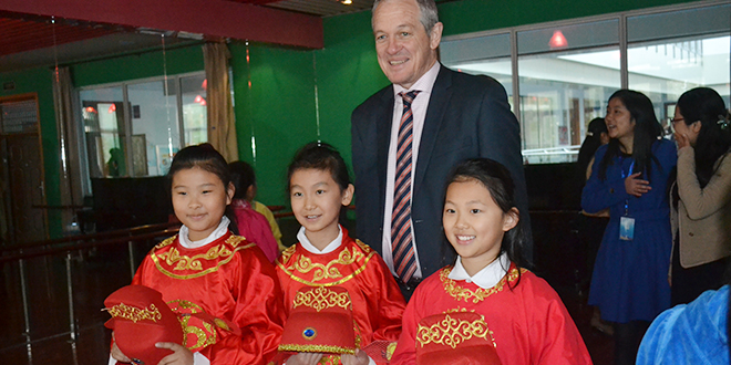 Broad vision: Dr Stephen Brown with students during his recent study tour of Anhui Province in China
