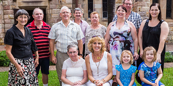 Faith family: Parishioners from St Mary's, Beaudesert, (standing) Mira Moran, Barry Kerwin, Greg Moran, Ray Gilbert, Lorraine Chick, catechumen Kelli Buhse and husband Greg Buhse and Naomi Hughes; and (seated) Margaret McGrath, Jodi Chick, Maddelyn Buhse and Madelaine Hughes at the Rite of Election at St Stephen's Cathedral. Photo: Alan Edgecomb