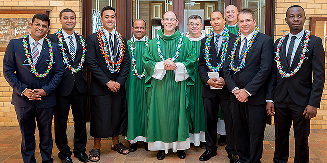 New journey: At the Holy Spirit Provincial Seminary Commencement Mass (from left) Ashwin Acharya, Francis Fernandes, William Aupito Iuliano, Fr Josekutty Vadakkel, Monsignor Anthony 	Randazzo, Carmelite Father Paul Chandler, Tyron Stewart, Fr Morgan Batt, Damien Everitt and Johnpaul Ezeakunne. Photo: Alan Edgecomb
