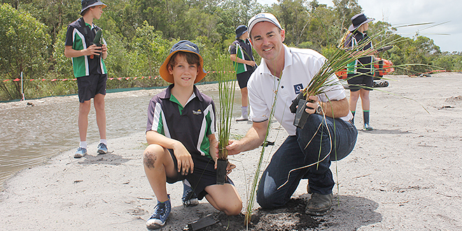Helping hand: Mark Stephens, from Stockland, with Unity College students Sam Scully (kneeling), Oliver Scully, Finlay Wells and Lillian Quantrell planting seedlings at Caloundra South wetlands.