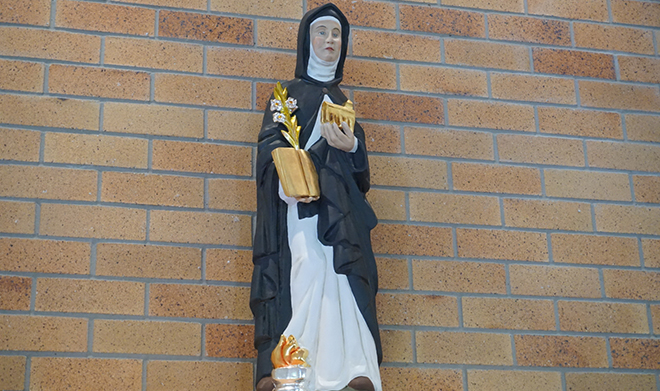 Commemorative statue: The depiction of St Brigid watching over the church.