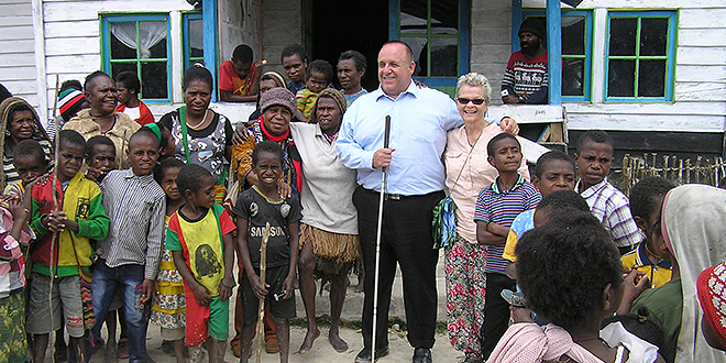Life-changing trip: Executive officer of Brisbane archdiocese's Catholic Justice and Peace Commission Peter Arndt and Carole Powell, a nurse from Morayfield on a trip to West Papua.