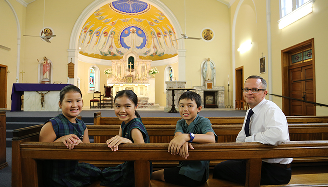 Thrilling return: Eve McClurg, Joanna Chang, Anthony Hamilton-Smiles and Micheal O'Sullivan are happy St Joseph's Church Kangaroo Point is open after being closed for renovations.