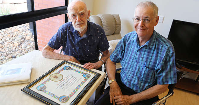 100 not out: Bill Thornton and his son Br Neville Thornton with the apostolic blessing from Pope Francis in honour of Bill's milestone birthday. Photo: Paul Dobbyn