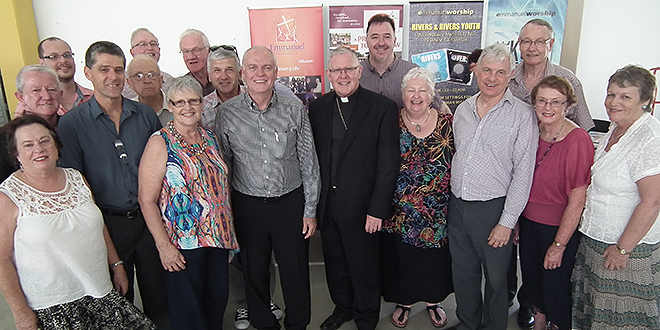 Community spirit: Archbishop Mark Coleridge with current and previous elders of Emmanuel Community (from left) Cathy Ledwich, John O'Brien, Luke Plant, Greg Shakhovskoy, Terry Finn, Mike Humphrys, Helen Plant, Bruce Lane, Robert Falzon, Shayne Bennett, Arthur Wilson, Mary Hare, Frank Davies, Les Savage, Monica O'Shea and Hilary Scarce.