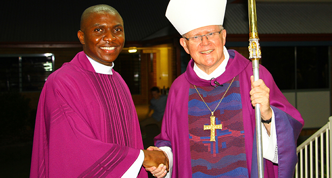 """Unexpected mission: Fr Chima Ofor """"least expected"""" to be Petrie community's parish priest but joyously took on his new role when he was installed by Archbishop Mark Coleridge on February 28."""