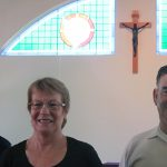 In loving memory: Rod Weekes, Noelene Robertson and Jim McNaught have paid tribute to their sister and late-wife Keran McNaught when they unveiled their gift of leadlight glass windows at St Joseph's church, Gayndah, last month.