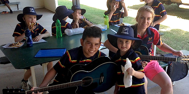 Generous hearts: Blackall's St Joseph's School teacher Lisa Alexander and students take part in a fundraising activity to support schools impacted by Cyclone Marcia.