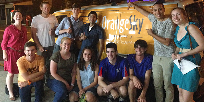 Role models: Anita Hendrie, left, with Orange Sky Laundry founders Nicholas Marchesi, second left, and Lucas Patchett, front left and Edmund Rice Camps volunteers.