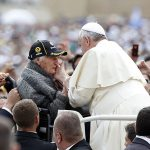 Pope Francis greets elderly woman