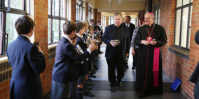 Blessing day: Archbishop Mark Coleridge, Marist Father John Gillen and guests were greeted by a special ensemble of Ambrose Treacy College boys playing bells.