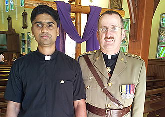 Remembering the Anzacs: Missionary Congregation of the Blessed Sacrament Father Josen Antony (left) after his first Anzac Day Mass with Deacon Peter Devenish-Meares at Sacred Heart Church, Jubilee.