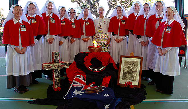 Uniform support: Students take part in Anzac Day remembrance events at Our Lady's College, Annerley.