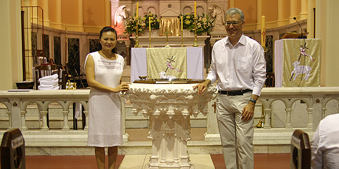 New Catholics: Steffanie Le and Simon Brown baptised at the Easter Vigil Mass at St Mary's Church, South Brisbane.