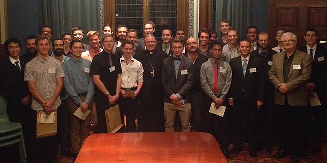 Priestly dinner: Brisbane Archbishop Mark Coleridge (centre) invited 40 young men to dine at his home, Wynberg, for the annual Archbishop's Vocations Dinner last week.