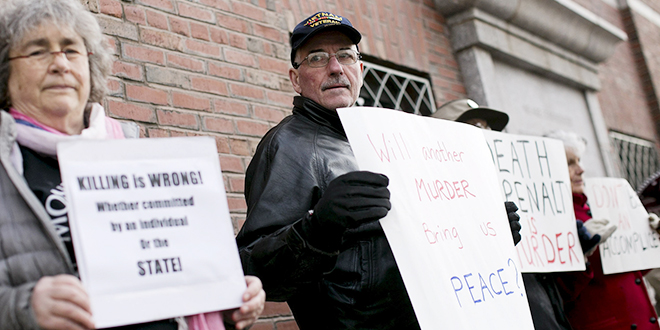 Life over death: Protesters against the death penalty hold signs before closing arguments took place on April 6 in the trial of accused Boston Marathon bomber Dzhokhar Tsarnaev at the federal courthouse in Boston. Photo: CNS/Dominick Reuter, Reuters