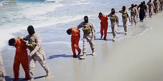 Church of martyrs: Islamic State militants lead what are said to be Ethiopian Christians along a beach in Libya in this image from an undated video made available on a social media website on April 19. Photo: CNS