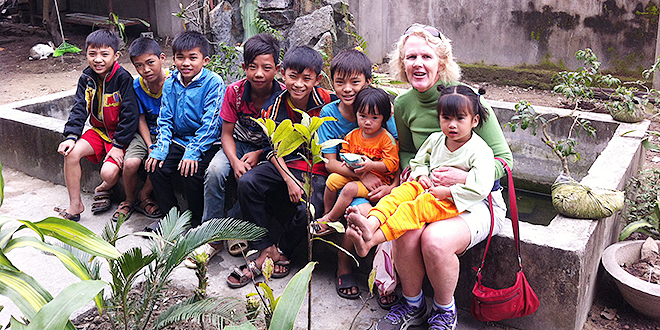 Teaching experience: Catholic woman and head of religious education at St Paul's School, Bald Hills, Monica Keating (above) with children from Tay Yen village, North Vietnam.