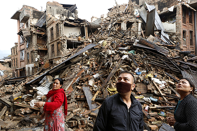 Disaster zone: Survivors look at destroyed buildings following an earthquake in Bhaktapur, Nepal. More than 4000 people were known to have been killed and more than 6500 others injured after a magnitude-7.9 earthquake hit a mountainous region near Kathmandu on April 25. Photo: CNS