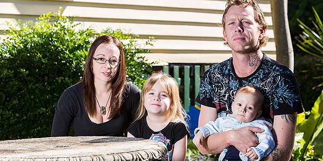 Daily battle: Moggill family Aimee and Jared Smith, with their children Lily and Lucian, like many others, find life hard on the basic wage. Photo: Alan Edgecomb