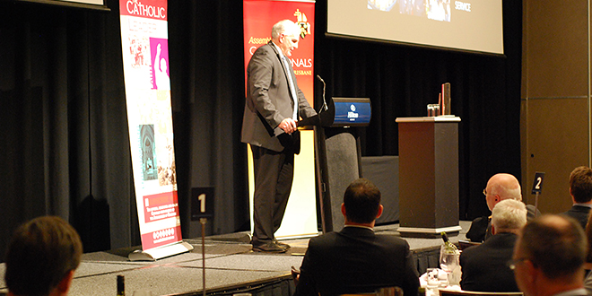 Financial services leader QIC chief executive officer Damien Frawley shares about faith complementing business practices at a recent Assembly of Catholic Professionals luncheon.