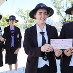 Reaching out: Lourdes Hill College students Caitlin Kearney, Grace Alchin, Tessa Onraet and Tahnee Snelleksz with their $26,000 cheque for Caritas Australia's Project Compassion.