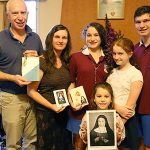 Saintly connection: Paul and Genevieve Swan with four of their five children, Daniel, Caitlyn, Rebecca and Felicity holding the official invitation to the canonisation of their relative, Blessed Marie-Alphonsine Danil Ghattas.
