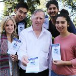 Thriving chaplaincy: QUT chaplain Fr Bavin Clark (centre) with students and Freedom missionaries Amanda Schoenfelder, Gerard Lai, Arnaud Hurdoyal and Grace Rutty handing out pamphlets for their upcoming conference in July.