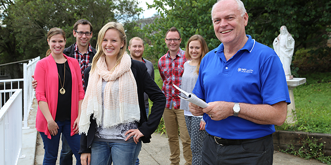 Missionary mindset: Inspired by Pope Francis' encyclical Envangelii Gaudium, Shayne Bennett (right) has asked Renee and Mark Doyle (NET Ministries Australia), Amanda Schoenfelder (Freedom Ministries), Travis Schoenfelder, Robert Shroeders (Freedom Ministires), and Niamh Healy to train the next generation of Catholic missionaries.