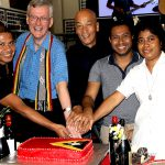 Timorese party: At Brisbane's Timor-Leste community celebrations are (from left) David Guterres, Fr Gerry Hefferan, Mario Ricardo, Aurelio Costa and Canossian Sister Odete Moreira cutting a cake bearing the Timorese flag at their Independence Day celebrations. Photo: Mundu Corbafo