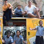 Serving schools: Orange Sky Laundry founders Nicholas Marchesi and Lucas Patchett with students from St James College, Spring Hill. Photo: Rene Marcel